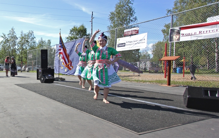 Hmong dancers perform during a World Refugee Day celebration at Mountain View Lions Park, June 2014.