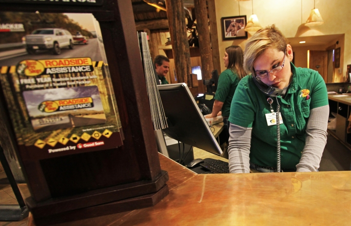 Mountain View resident Cassandra Knight at work at Mountain View's new Bass Pro Shops Outpost, which opened at Glenn Square in summer 2014.