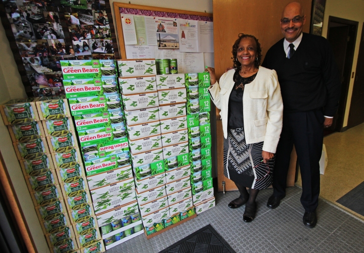 Mary Epperson and Rev. Alphonso Meadows with a stack of canned goods donated for the Food Bank of Alaska's annual Thanksgiving Blessing.