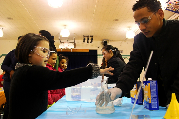 Dozens of kids tried simple science experiments with the help of volunteers from the East High School JROTC.