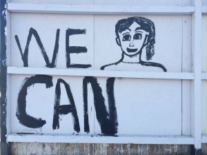 Art on the fence surrounding 3543 Mountain View Drive, the site of this year's neighborhood spring cleanup.