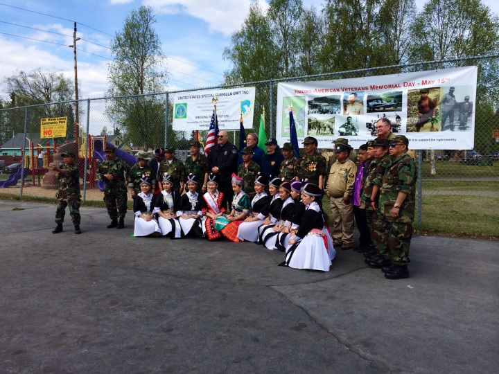 Hmong veterans and dancers pose for a photo at memorial event May 15.