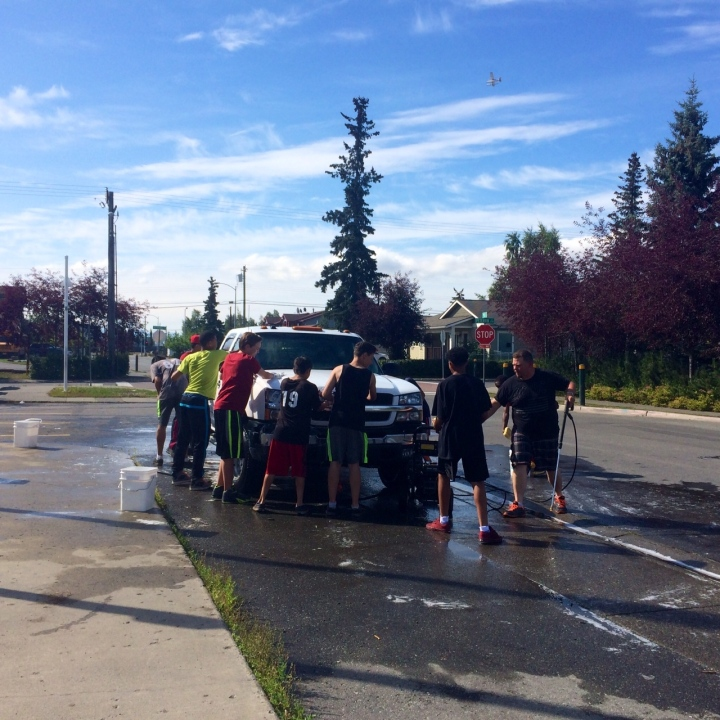 The Polar Little League juniors' team raising money with a car wash at the Mountain View Boys & Girls Club.