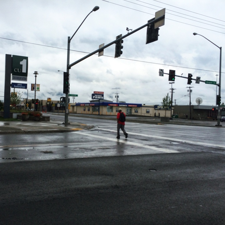 Ralph Maillelle walks to work at West Berlin on a rainy morning in July.