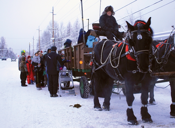 Jon Nauman, owner of the Horse-Drawn Carriage Co., leads hay rides for families at the Mountain View Winter Festival.
